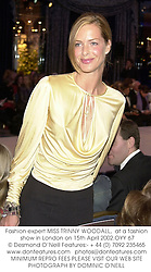Fashion expert MISS TRINNY WOODALL,  at a fashion show in London on 15th April 2002.OYY 67
