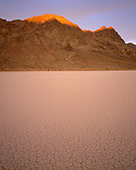 """CADDV_023 - USA, California, Death Valley National Park, Sunrise on Ubehebe Peak above dry lakebed or playa called """"Racetrack"""". (4800x6000 px)"""