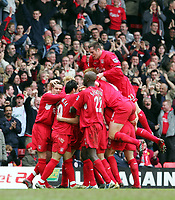 Photo: Andrew Unwin.<br />Liverpool v Everton. The Barclays Premiership. 25/03/2006.<br />Liverpool celebrate their third goal scored by Harry Kewell.