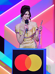 Dua Lipa accepts the award for Female Solo Artist during the Brit Awards 2021 at the O2 Arena, London. Picture date: Tuesday May 11, 2021.