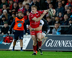 Johnny McNicholl of Scarlets under pressure from George North of Ospreys<br /> <br /> Photographer Simon King/Replay Images<br /> <br /> Guinness PRO14 Round 11 - Ospreys v Scarlets - Saturday 22nd December 2018 - Liberty Stadium - Swansea<br /> <br /> World Copyright © Replay Images . All rights reserved. info@replayimages.co.uk - http://replayimages.co.uk
