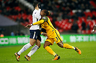 Erik Lamela of Tottenham Hotspur (L) collides with Gaetan Bong of Brighton & Hove Albion (R). Premier league match, Tottenham Hotspur v Brighton & Hove Albion at Wembley Stadium in London on Wednesday 13th December 2017.<br /> pic by Steffan Bowen, Andrew Orchard sports photography.