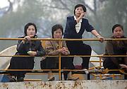 North Korean women on a boat in the border town of Sunuiju Ocotber 10, 2006.
