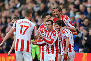 Peter Crouch of Stoke City (r) celebrates with his teammates after scoring his teams 2nd goal to make it 2-2. Premier league match, Stoke City v Leicester City at the Bet365 Stadium in Stoke on Trent, Staffs on Saturday 4th November 2017.<br /> pic by Chris Stading, Andrew Orchard sports photography.