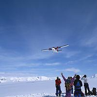 A twin Otter plane drops ski mountaineers atop Detroit Plateau.