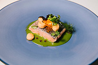 """GARDONE RIVIERA, ITALY - 19 APRIL 2018: A trout filet cooked in its own broth and caviar is seen here at """"Il Fagiano"""" restaurant at the Grand Hotel Fasano in Gardone Riviera, Italy, on April 19th 2018.<br /> <br /> Lake Garda is the largest lake in Italy. It is a popular holiday location located in northern Italy, about halfway between Brescia and Verona, and between Venice and Milan on the edge of the Dolomites. The lake and its shoreline are divided between the provinces of Verona (to the south-east), Brescia (south-west), and Trentino (north)."""