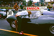 Whitsun Sports car race 3 June 1963, John Coundley in Jaguar D-type car on start line, Goodwood, England, UK, his wife Pat leaning over