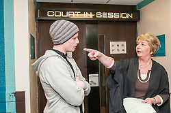 Defendant outside court speaking to the duty usher in Sheffield
