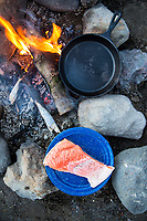 Cooking salmon while camping near Bend, Oregon.
