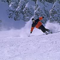 "SKIING, Big Sky, MT. Patrick Shanahan (MR) carves high speed turns on ""Upper Morning Star"" run below Triple Chair."