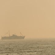 A ship heads into the heavy haze on Istanbul's Bosphorus Strait.