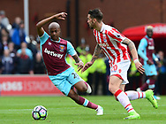 Andre Ayew of West Ham challenges Geoff Cameron of Stoke city. Premier league match, Stoke City v West Ham Utd at the Bet365 Stadium in Stoke on Trent, Staffs on Saturday 29th April 2017.<br /> pic by Bradley Collyer, Andrew Orchard sports photography.