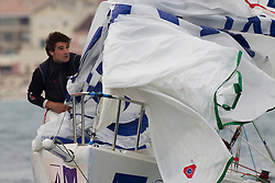 Francois Verdier pulls in a spinaker   during Match race France in Marseille,France 8 April 2010 Photo: Brendon O'Hagan/Subzero images