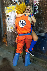 © Licensed to London News Pictures . 27/12/2016 . Wigan , UK . A couple wearing Dragon Ball Z themed outfits . Revellers in Wigan enjoy Boxing Day drinks and clubbing in Wigan Wallgate . In recent years a tradition has been established in which people go out wearing fancy-dress costumes on Boxing Day night . Photo credit : Joel Goodman/LNP