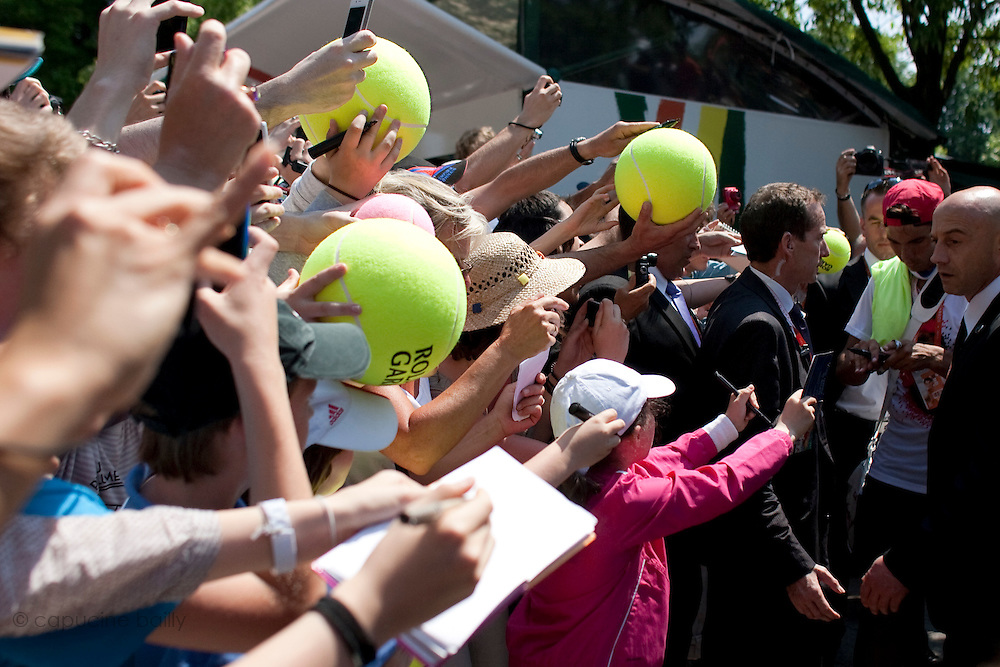 Roland Garros. Paris, France. May 27th 2012.People want Rafael Nadal's autograph and picture after his training session...