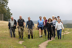 Licensed to London News Pictures. 08/10/2021. London, UK. Members of a Nordic walking club enjoy the misty mild temperatures of 15c, (8c warmer than usual) this morning in Richmond Park, south-west London as weather experts reveal that today could be the UK's warmest October morning on record. Temperatures are also predicted to rise this afternoon with highs of 21c expected. Photo credit: Alex Lentati/LNP