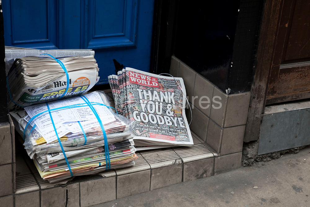 """The last ever copies of tabliod newspaper News of The World land on the doorstep. Sunday 10th July 2011 saw the end for this most famous of newspapers. Embroiled in the phone hacking scandal, this News International paper had approximately 7 million readers at the time of it's demise. On the cover of this, the final edition, with examples of previous journalistic success the headline simply read """"Thank You & Goodbye""""."""