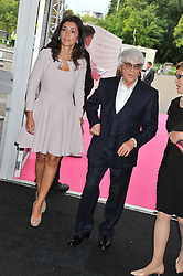 BERNIE ECCLESTONE and FABIANA FLOSI at the F1 Party in aid of Great Ormond Street Hospital Children's Charity held at Battersea Evolution, Battersea Park, London on 4th July 2012.
