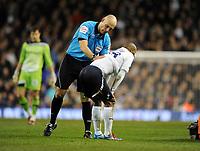 Jermain Defoe is comforted by Referee Howard Webb after Bolton Wanderers Player Fabrice Muamba collapes<br />Tottenham Hotspur 2011/12<br />Tottenham Hotspur V Bolton Wanderers 17/03/12<br />The FA Cup 6th Round<br />Photo: Robin Parker Fotosports International