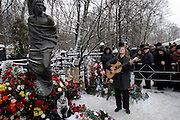 Moscow, Russia, 25/01/2004..Hundreds of Russians gather at the grave of legendary dissident singer, poet and actor Vladimir Vysotsky on his birthday. Vysotsky, who died in 1980 aged 42 of a heart attack, is best known for his songs of Soviet prison life. Much of his work was officially unpublished during his lifetime, and he remains a potent anti-authoritarian symbol of protest to Russians of all ages even today.