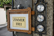 A Zimmer Frei (Room Free) sign is posted next to dials for temperature, pressure and humidity, in Appenzell village, Switzerland, Europe.