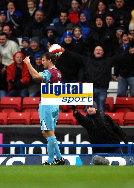 Photo: Paul Greenwood.<br />Blackburn Rovers v West Ham United. The Barclays Premiership. 17/03/2007.<br />Blackburn fans offer Lucas Neill their tickets on his return to the Blackburn pitch