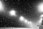 Competitors warm up in heavy snow for the finals of the men's ski halfpipe at Rosa Khutor Extreme Park during the Winter Olympics in Sochi, Russia, Tuesday, Feb. 18, 2014. (Brian Cassella/Chicago Tribune/MCT)