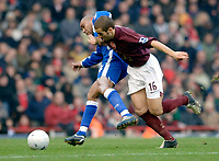 Photo: Daniel Hambury.<br />Arsenal v Cardiff City. The FA Cup. 07/01/2006.<br />Arsenal's Mathieu Flamini and Cardiff's Jeff Whitley battle for the ball.