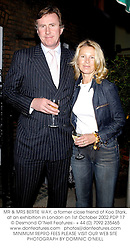 MR & MRS BERTIE WAY, a former close friend of Koo Stark, at an exhibition in London on 1st October 2002.PDP 17