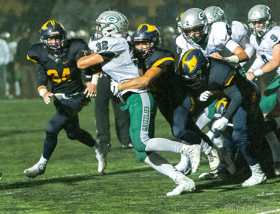 Granite Bay Grizzlies Drew Yeargin (32), is tackled as he runs with the ball during the second quarter as the Oak Ridge High School Trojans host the Granite Bay Grizzlies, Friday Oct 14, 2016.<br /> photo by Brian Baer
