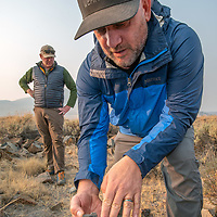 Archaeologists investigate artifacts at an early Native American settlement in the White Mountains of California.  LtoR:  Luke Barton & Micah Hale.