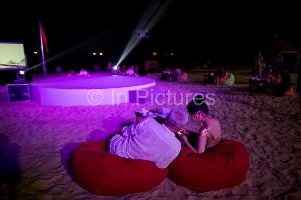 Participants of Diamond Love, a high-end dating service, chat and mingle while attending a beach dinner party in Sanya, Hainan Province,  China on15 June  2013.  Male participants of the dating service pay up to 20,000 USD to attend such events in hopes of finding a suitable match while most of the women are selected by the match making service according to their looks, education, and personality.