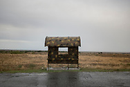 A military camouflage pattern is painted on a bus stop at Tigranakert, Nagorno-Karabakh. In the late 1980s and especially in the early 1990s, Nagorno-Karabakh was convulsed by war as Armenians and Azerbaijanis fought over control for the territory. Populated mostly by Armenians, since 1991 it has been a de facto independent state, calling itself the Republic of Artsakh. Internationally, however, it is still recognized as belonging to Azerbaijan. The conflict continues to simmer today.
