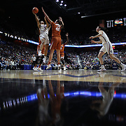 UNCASVILLE, CONNECTICUT- DECEMBER 4:  Gabby Williams #15 of the Connecticut Huskies drives to the basket defended by Kelsey Lang #40 of the Texas Longhorns during the UConn Huskies Vs Texas Longhorns, NCAA Women's Basketball game in the Jimmy V Classic on December 4th, 2016 at the Mohegan Sun Arena, Uncasville, Connecticut. (Photo by Tim Clayton/Corbis via Getty Images)