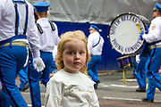 Young child watches as members of the Orange Order parade through Central Belfast.  <br /> <br /> Orange March, Belfast, NI,2021