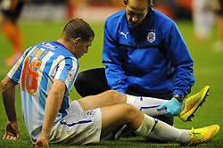 Huddersfield Town's Grant Holt goes down injured - Photo mandatory by-line: Dougie Allward/JMP - Mobile: 07966 386802 - 01/10/2014 - SPORT - Football - Wolverhampton - Molineux Stadium - Wolverhampton Wonderers v Huddersfield Town - Sky Bet Championship