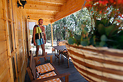 Jeff, Lauras's husband in one of the houses of the Naturist Camping Park, Monte Barão.