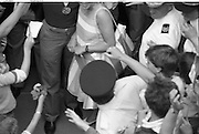 1983-15-08.15th August 1983.15-08-1983.08-15-83. .Photographed at Dublin Airport..Surrounded:..Yvonne Coughlan stands beside her husband World Atletics champion, Eamonn as a fan seeks auutograph.