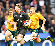Chris Ashton of England runs in his second try past Drew Mitchell during the Investec series international between England and Australia at Twickenham, London, on Saturday 13th November 2010. (Photo by Andrew Tobin/SLIK images)