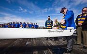 Howard Campbell christens a new rowing shell prior to the annual Brown Cup regatta between the University of Victoria and University of British Columbia at the Gorge Waterway in Victoria, British Columbia Canada on March 25, 2017.