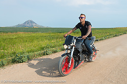 Cyclone Jake Wheeler on a ride with fellow American Motordrome Wall of Death riders on the back roads north of Sturgis during the Sturgis Black Hills Motorcycle Rally. SD, USA. August 4, 2014.  Photography ©2014 Michael Lichter.