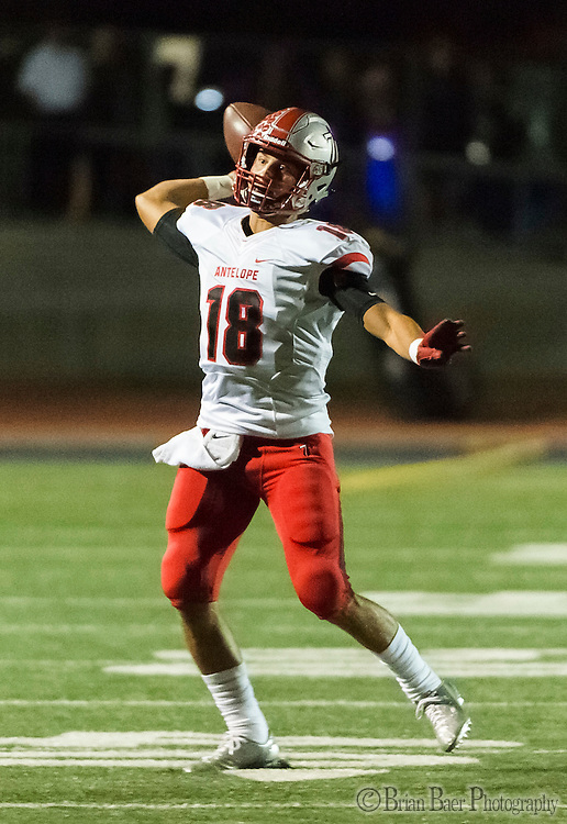 Antelope High School Titans Nick Spagnola (18), passes the ball during the second quarter as the Oakmont High School Vikings host the Antelope High School Titans Friday Sep 30, 2016.<br /> photo by Brian Baer
