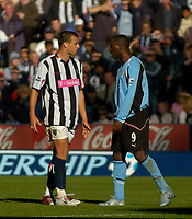Photo. Glyn Thomas. Digitalsport<br /> West Bromwich Albion v Fulham. <br /> Barclays Premiership. 18/09/2004.<br /> Fulham's Andy Cole (R) squares up to and aims a punch at West Brom's Neil Clement (L) after Clement was shown the red card. Cole was also then shown the red card.