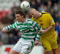 Clyde v Celtic, ScottishCup  quarter final, Broadwood Stadium, Cumbernauld. Sunday 27/02/2005<br /> Alan Thompson heads over the bar under pressure from Simon Mensing