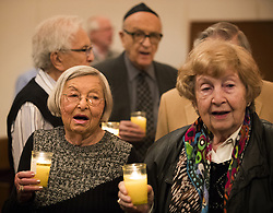 April 12, 2018 - St. Paul, MN, U.S.A - Holocaust survivors Eva Gross, left, and Edith Goodman, right, stand with other survivors holding candles to sing ''America the Beautiful.'' ] LEILA NAVIDI • leila.navidi@startribune.com ....BACKGROUND INFORMATION: The Twin Cities Annual Yom HaShoah Commemoration at Mount Zion Temple in St. Paul on Thursday, April 12, 2018. ORG XMIT: MIN1804122047460963 (Credit Image: © Leila Navidi/Minneapolis Star Tribune via ZUMA Wire)