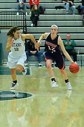 06 December 2017:  Hannah Williams defended by Sydney Shanks during an NCAA women's basketball game between the Wheaton Thunder and the Illinois Wesleyan Titans in Shirk Center, Bloomington IL