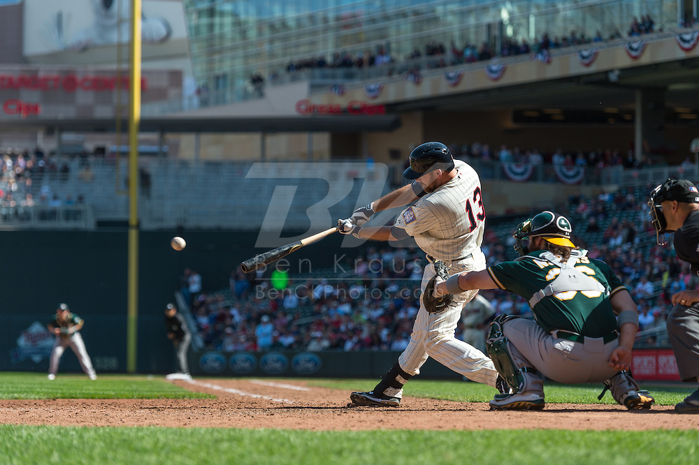 Jason Kubel #13 of the Minnesota Twins connects for a single against the Oakland Athletics on April 9, 2014 at Target Field in Minneapolis, Minnesota.  The Athletics defeated the Twins 7 to 4.  Photo by Ben Krause