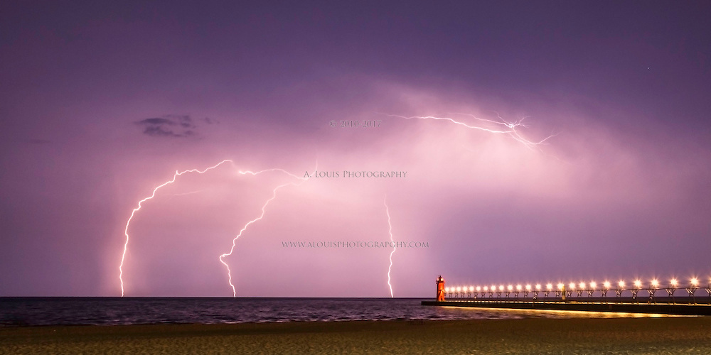 """""""Pitchfork""""  Multiple lightning strikes resembling a pitchfork over the lighthouse in South Haven, MI---  This is image is recommended for printing on metallic paper."""