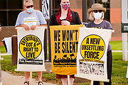 """07 JUNE 2021 - DES MOINES, IOWA: People participate in a Moral Monday demonstration in Des Moines. About 20 representatives from The Poor People's Campaign in Des Moines gathered near the State Capitol for a """"National Call for Moral Revival."""" It was a part of a national effort to build a """"Third National Reconstruction."""" They called for a living wage that reflects the cost of living in Iowa (working at the state minimum wage, it takes 80 hours of work per week to afford a two bedroom apartment) and end military support for Iowa police agencies (between 2008-2014, Iowa law enforcement agencies got $7.7 million in military grade equipment.)          PHOTO BY JACK KURTZ"""