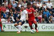 Liverpool's Jordon Ibe (r) looks to go past Preston North End's David Buchanan. pre-season friendly match, Preston North End v Liverpool at Deepdale in Preston, England on Saturday 19th July 2014.<br /> pic by Chris Stading, Andrew Orchard sports photography.